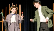 """BOTH IN SONG AND WITH WORDS, senior Morgan Moravitz wowed the audience at Washington Auditorium while playing the lead role in  """"Mary Poppins,"""" the high school fall musical. Moravitz is pictured on stage with Elijah Olson. Photo by Hailey Worth."""